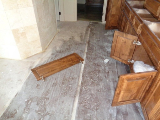 Click to Enlarge Damaged floor and Cabinets